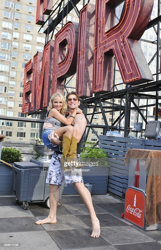 Kristin Chenoweth and Andy Karl of 'On the Twentieth Century' celebrate on the pool deck of The Empire Hotel on July 12, 2015 in New York City.