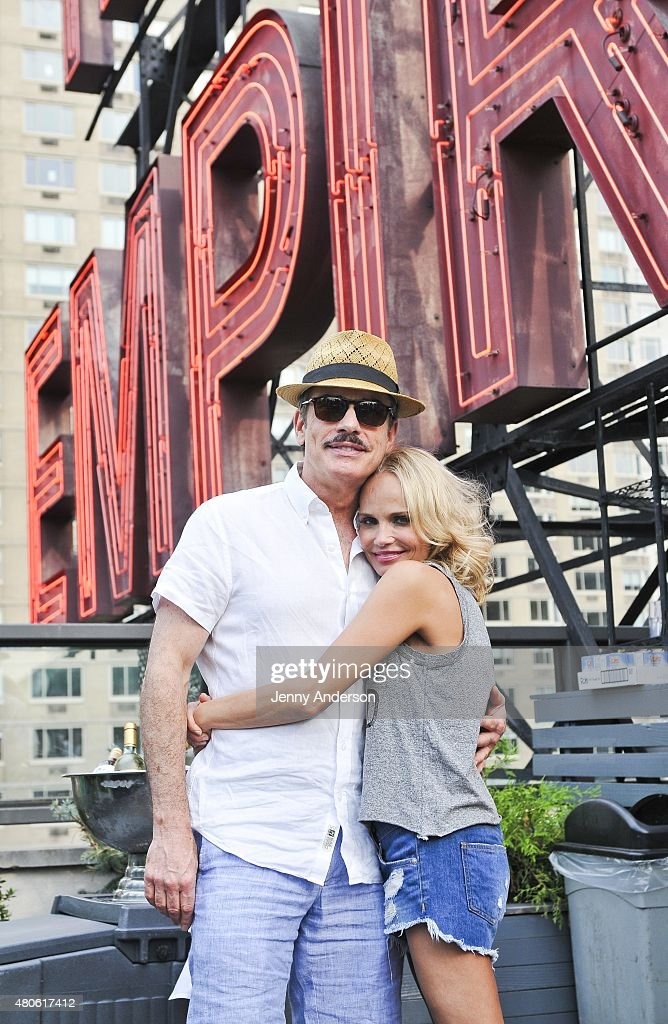 Kristin Chenoweth and Peter Gallagher of 'On the Twentieth Century' celebrate on the pool deck of The Empire Hotel on July 12, 2015 in New York City.