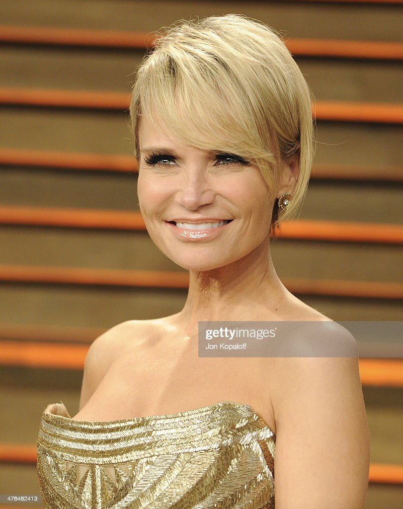 <a gi-track='captionPersonalityLinkClicked' href=/galleries/search?phrase=Kristin+Chenoweth&family=editorial&specificpeople=207096 ng-click='$event.stopPropagation()'>Kristin Chenoweth</a> attends the 2014 Vanity Fair Oscar Party hosted by Graydon Carter on March 2, 2014 in West Hollywood, California.