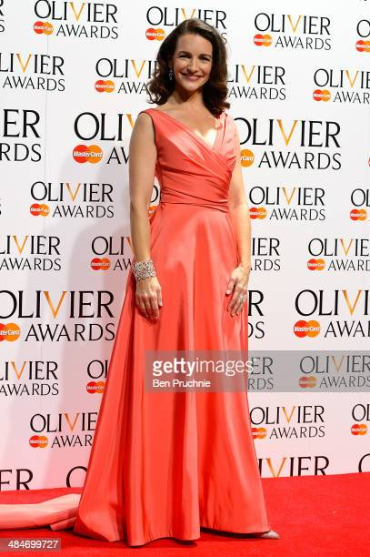 Kristin Davis poses for photographers in the press room at the Laurence Olivier Awards at The Royal Opera House on April 13 2014 in London England