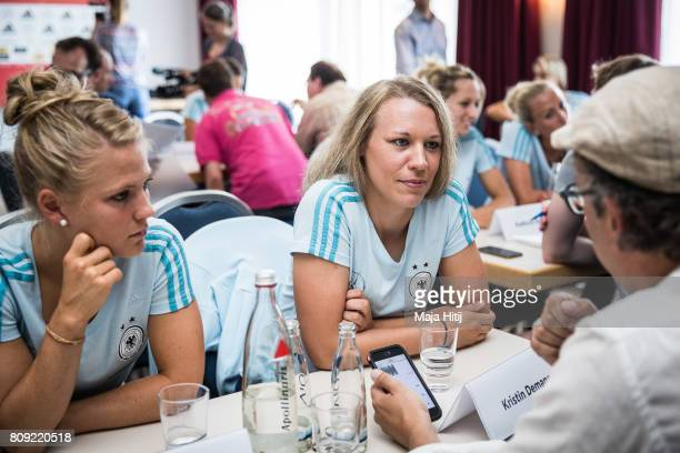Kristin Demann listens during a interview at Germany Women's National Soccer Team Media Day on July 5 2017 in Heidelberg Germany