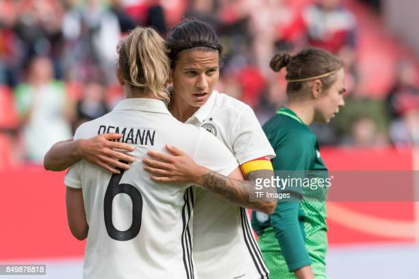 Kristin Demann of Germany and Dzsenifer Marozsan of Germany celebrate a goal during the 2019 FIFA women's World Championship qualifier match between...