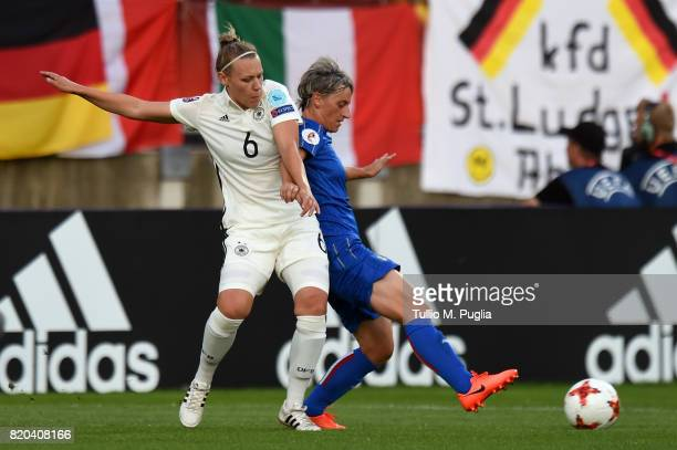 Kristin Demann of Germany and Melania Gabbiadini of Italy compete for the ball during the UEFA Women's Euro 2017 Group B match between Germany and...