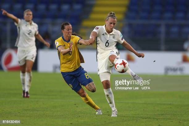 Kristin Demann of Germany battles with Lotta Schelin of Sweden during the UEFA Women's Euro 2017 Group B match between Germany and Sweden at Rat...