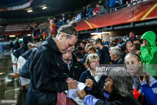 Kristin Demann of Germany gives autographs to the fans after the game was postponed due to heavy rain prior to the UEFA Women's Euro 2017 Quarter...