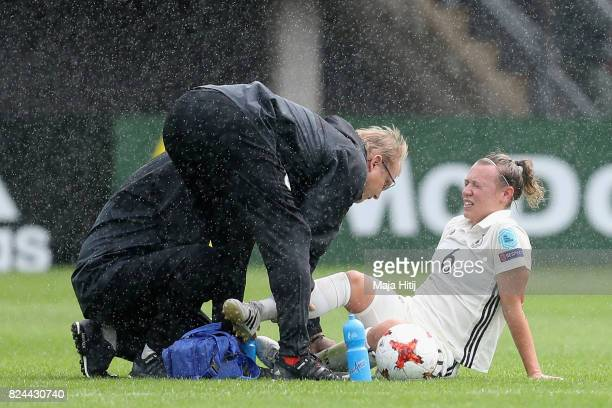 Kristin Demann of Germany receives treatment from the medical team during the UEFA Women's Euro 2017 Quarter Final match between Germany and Denmark...