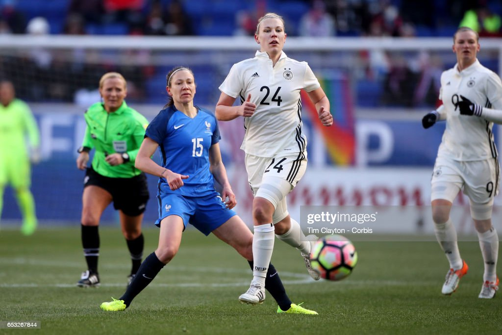 Kristin Demann #24 of Germany watched by Elise Bussaglia #15 of France during the France Vs Germany SheBelieves Cup International match at Red Bull Arena on March 4, 2017 in Harrison, New Jersey.