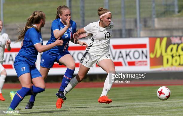 Kristin Dis Arnadottir Mist Thormodsdottir and Laura Freigang battle for the ball during the U19 women's elite round match between Germany and...
