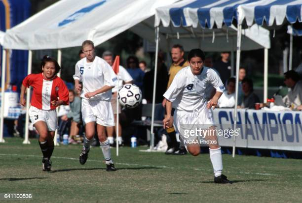 Kristin Jones of the University of CaliforniaSan Diego chases a loose ball while Kanae Haneishi of Christian Brothers University and Christine Wensel...
