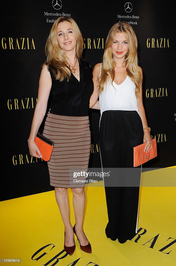 Kristin Meyer and Susan Sideropoulos attend the Mercedes-Benz Fashion Week Berlin Spring/Summer 2014 Preview Show by Grazia at the Brandenburg Gate on July 1, 2013 in Berlin, Germany.