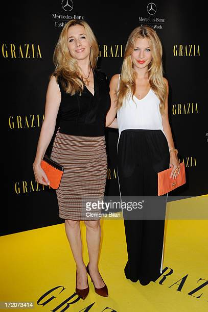 Kristin Meyer and Susan Sideropoulos attend the MercedesBenz Fashion Week Berlin Spring/Summer 2014 Preview Show by Grazia at the Brandenburg Gate on...