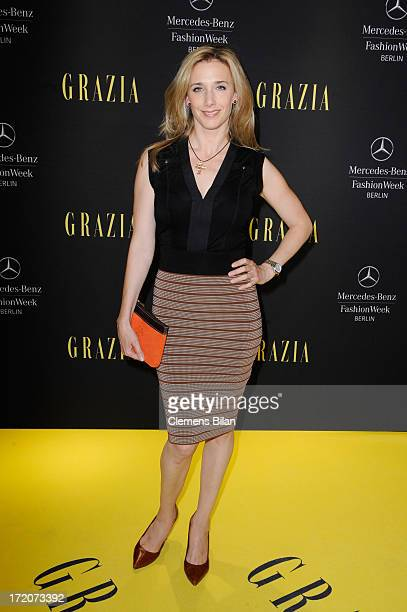 Kristin Meyer attends the MercedesBenz Fashion Week Berlin Spring/Summer 2014 Preview Show by Grazia at the Brandenburg Gate on July 1 2013 in Berlin...