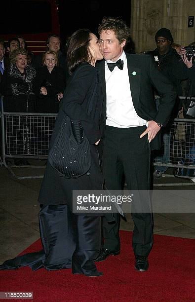 Kristin Scott Thomas and Hugh Grant during An Evening With Cirque Du Soleil Charity Performance and Dinner at Royal Albert Hall in London Great...