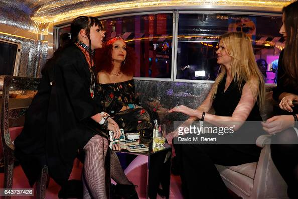 Kristin Scott Thomas and Lara Stone visit the fortune teller at LondonÕs Fabulous Fund Fair hosted by Natalia Vodianova and Karlie Kloss in support...