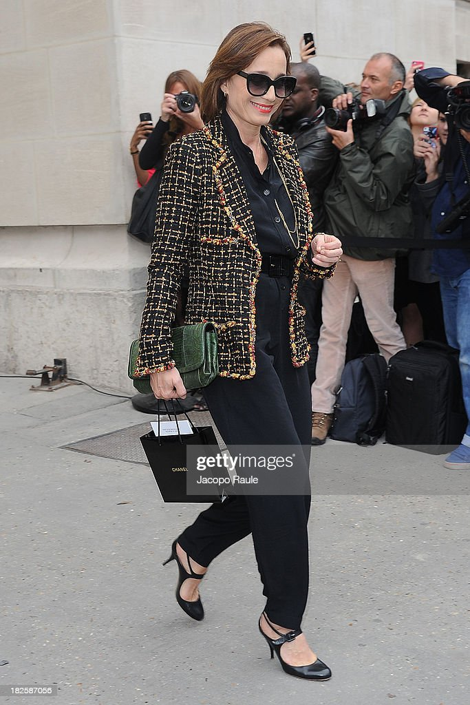 <a gi-track='captionPersonalityLinkClicked' href=/galleries/search?phrase=Kristin+Scott+Thomas&family=editorial&specificpeople=203290 ng-click='$event.stopPropagation()'>Kristin Scott Thomas</a> leaves the Chanel Fashion Show during Paris Fashion Week Womenswear SS14 - Day 8 on October 1, 2013 in Paris, France.