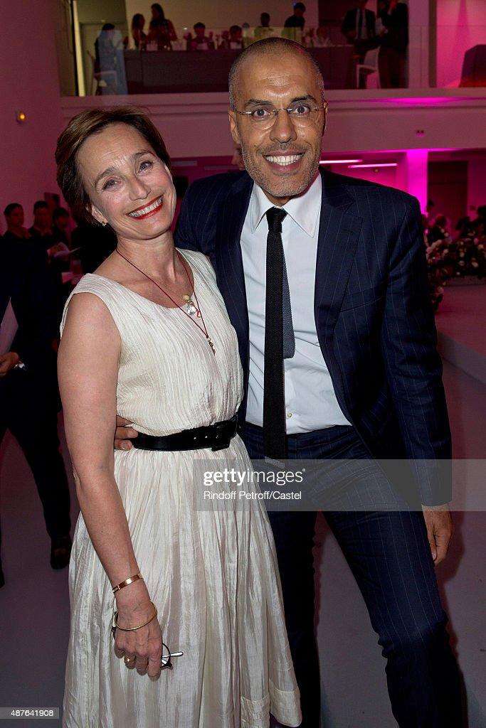 Kristin Scott-Thomas and Kamel Mennour attend the Auction Dinner to Benefit 'Institiut Imagine' on September 10, 2015 in Paris, France.