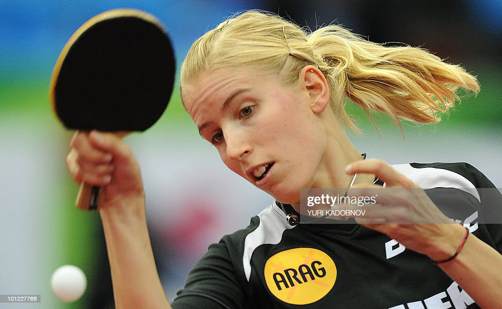 Kristin Sibereisen of Germany returns a service to Jiang Huajun of Hong Kong during the women's quarter final match at the 2010 World Team Table Tennis Championships in Moscow on May 28, 2010.