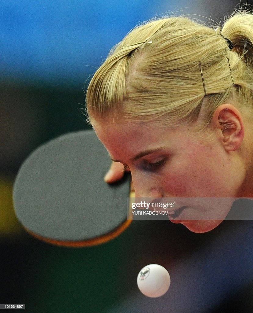 Kristin Silbereisen of Germany services to Yuegu Wang of Singapore during the women's semi final against at the 2010 World Team Table Tennis Championships in Moscow on May 29, 2010.