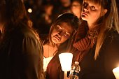 Kristin Sterner a freshman at Umpqua Community College mourns during a vigil in Roseburg Oregon on October 1 for ten people have been confirmed...