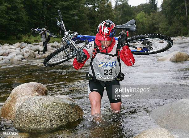 Kristina Anglem from the New Zealand team of Balance Vector crosses Giles Creek with her mountain bike on the third day of the Adventure Racing World...