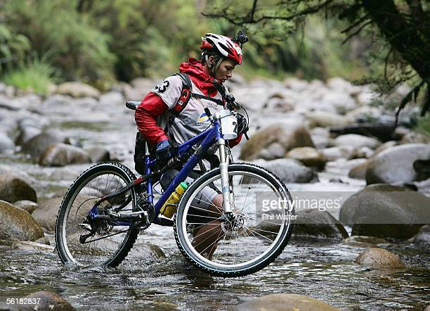 Kristina Anglem from the New Zealand team of Balance Vector crosses Goll Creek with her mountain bike on the third day of the Adventure Racing World...