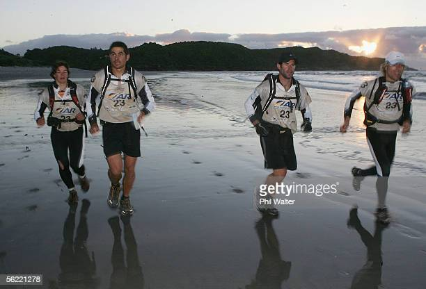 Kristina Anglem Nathan Fa'avae Richard Ussher and Marcel Hagener from the New Zealand team Balance Vector run down Nine Mile beach on the fifth day...