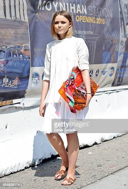 Kristina Bazan is seen outside the Prabal Gurung show wearing an hermes top and an Hermes bag and sandals on September 6 2014 in New York City