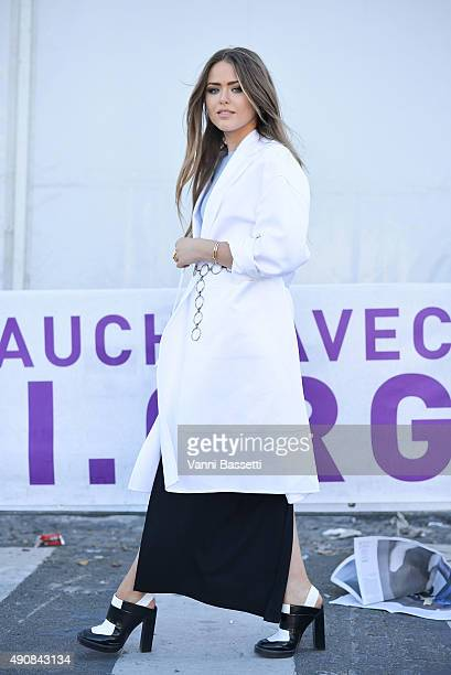 Kristina Bazan leaves after the Carven show at the Tuileries garden during Paris Fashion Week SS16 on October 1 2015 in Paris France