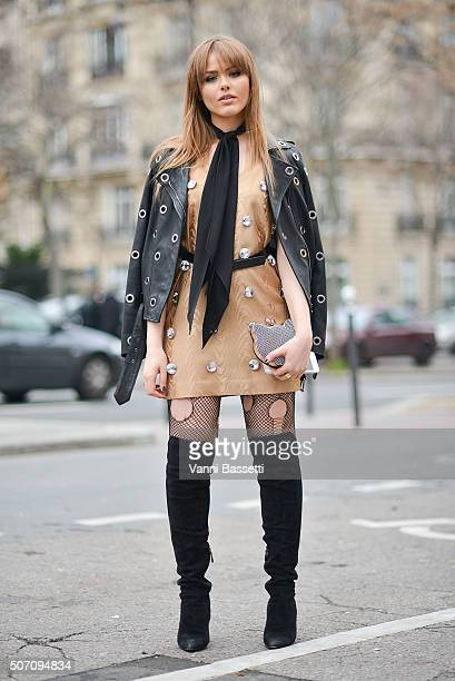 Kristina Bazan poses wearing a Lanvin jacket after the Viktor and Rolf show at the Palais de Tokyo during Haute Couture Spring Summer 16 on January...