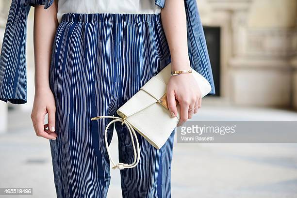 Kristina Bazan poses wearing Kenzo jacket and pants and Jimmy Choo bag on Day 5 of Paris Fashion Week Womenswear FW15 on March 7 2015 in Paris France