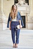 Kristina Bazan poses wearing Kenzo jacket and pants Jimmy Choo bag and Balenciaga shoes on Day 5 of Paris Fashion Week Womenswear FW15 on March 7...
