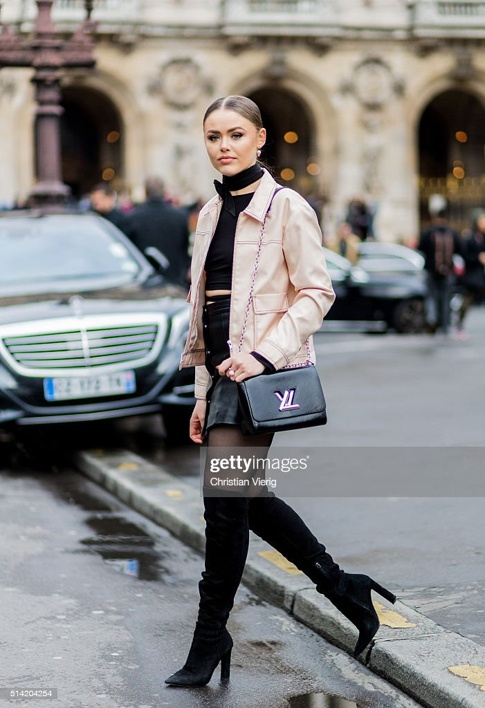 Kristina Bazan wearing a short black leather jacket, black overknees a black cropped top and jacket and a black Louis Vuitton bag outside Stella McCartney during the Paris Fashion Week Womenswear Fall/Winter 2016/2017 on March 7, 2016 in Paris, France.