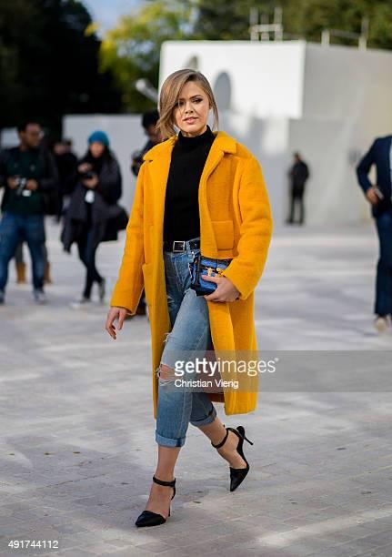 Kristina Bazan wearing Louis Vuitton bag Rochas coat Alexander Wang shoes at Louis Vuitton during the Paris Fashion Week Womenswear Spring/Summer...