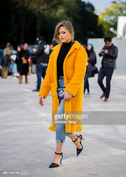 Kristina Bazan wearing Louis Vuitton bag Rochas coat Alexander Wang shoes at Louis Vuitton during the Paris Fashion Week Womenswear Spring/Summer...