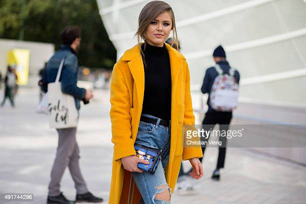 Kristina Bazan wearing Louis Vuitton bag Rochas coat at Louis Vuitton during the Paris Fashion Week Womenswear Spring/Summer 2016 on Oktober 7 2015...