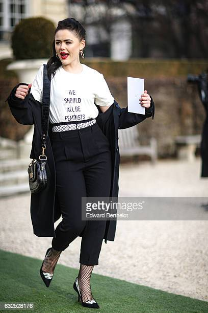 Kristina Bazan wears a white tshirt with the inscription 'we should all be feminists' and attends the Christian Dior Haute Couture Spring Summer 2017...