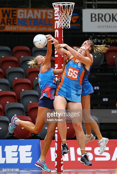 Kristina Brice of Canberra clashes with NSW defenders during round one of the ANL match between Canberra Giants and Netball NSW Waratahs at Sydney...