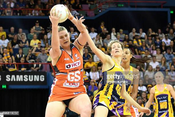 Kristina Brice of the Giants and Karla Mostert of the Lightning compete for the ball during the Super Netball Grand Final match between the Lightning...