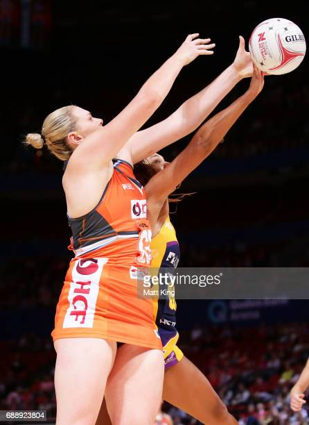 Kristina Brice of the Giants competes with Geva Mentor of the Lightning during the round 14 Super Netball match between the Giants and the Lightning...