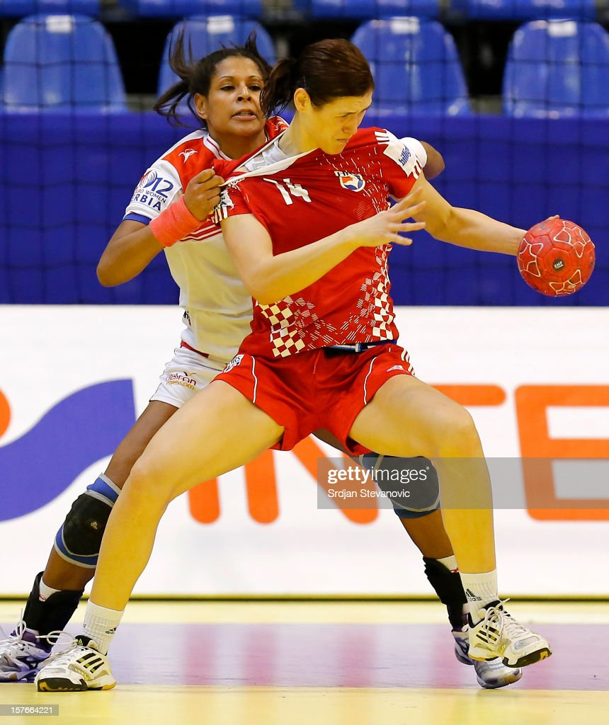Kristina Elez (R) of Croatia is challenged by Marta Mangue (L) of Spain during the Women's European Handball Championship 2012 Group C match between Spain and Croatia at Spens Hall on December 05, 2012 in Novi Sad, Serbia.