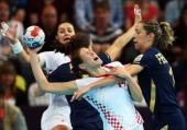 Kristina Franic of Croatia is defended by Begona Fernandez Molinos of Spain during the Women's Quarterfinal match between Spain and Croatia on Day 11...