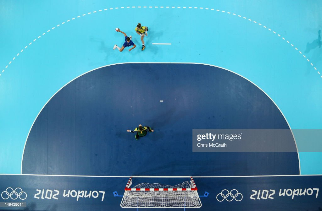 Kristina Franic of Croatia scores past Jelena Grubisic of Croatia in the Women's Handball preliminaries Group A - Match 3 between Croatia and Brazil on Day 1 of the London 2012 Olympic Games at the Copper Box on July 28, 2012 in London, England.