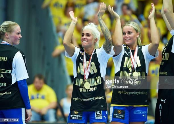 Kristina Kristiansen of Nykobing Falster Handbold and teammates celebrate after the Primo Tours Ligaen 3 Final match between Nykobing Falster...