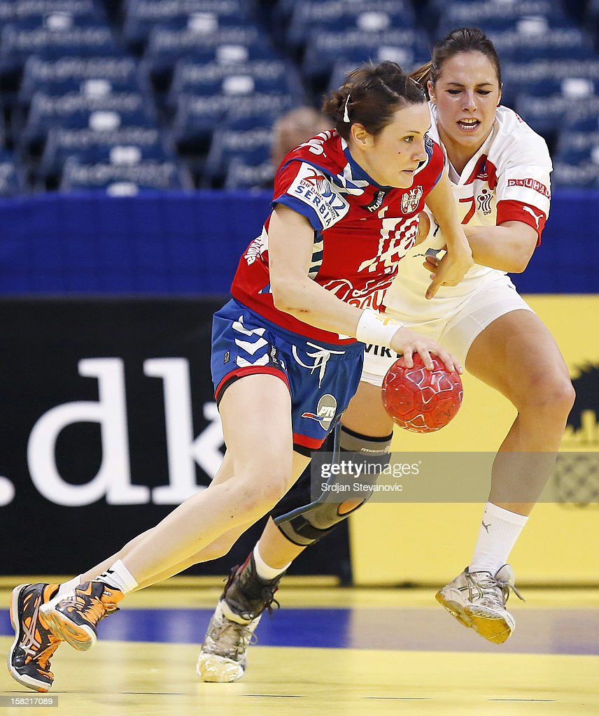 Kristina Liscevic (L) of Serbia is challenged by Louise Burgaard (R) of Denmark during the Women's European Handball Championship 2012 Group I main round match between Serbia and Denmark at Arena Hall on December 11, 2012 in Belgrade, Serbia.