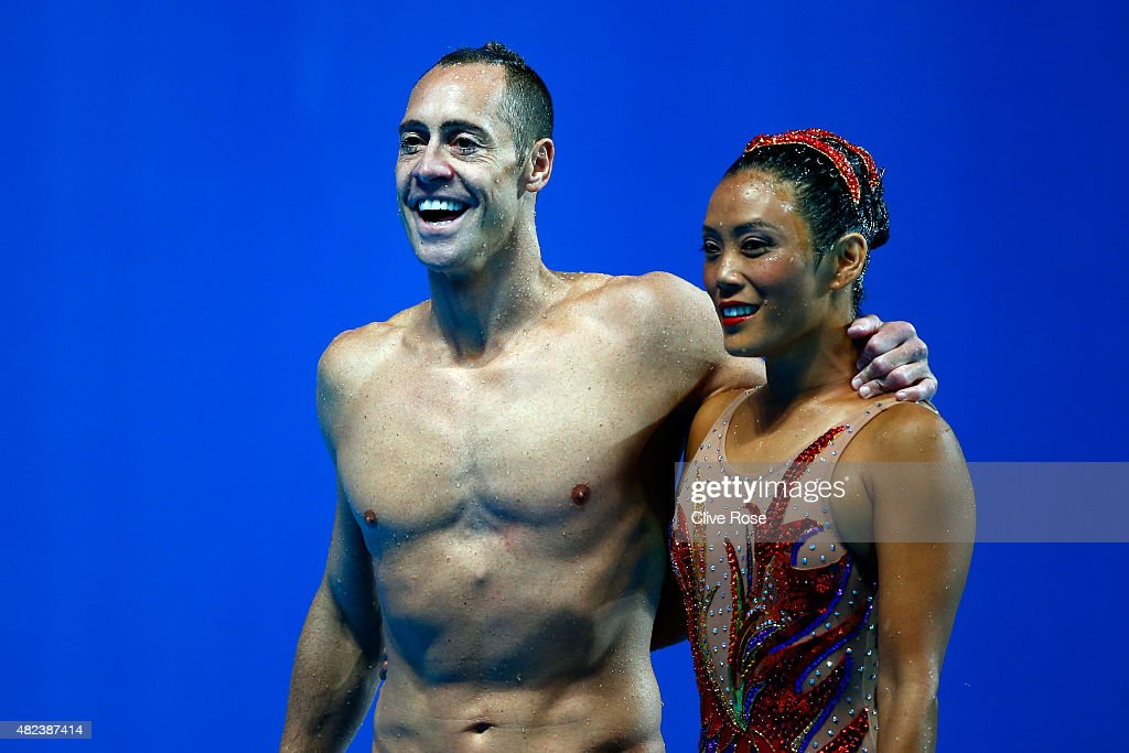 Kristina Lum-Underwood and Bill May of the United States wave after competing in the Mixed Duet Free Synchronised Swimming Final on day six of the 16th FINA World Championships at the Kazan Arena on July 30, 2015 in Kazan, Russia.