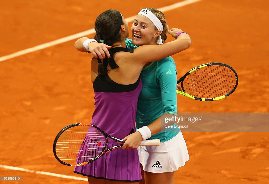 <a gi-track='captionPersonalityLinkClicked' href=/galleries/search?phrase=Kristina+Mladenovic&family=editorial&specificpeople=4835181 ng-click='$event.stopPropagation()'>Kristina Mladenovic</a> and <a gi-track='captionPersonalityLinkClicked' href=/galleries/search?phrase=Caroline+Garcia&family=editorial&specificpeople=6605758 ng-click='$event.stopPropagation()'>Caroline Garcia</a> of France celebrate match point against Elena Vesnina and Ekaterina Makarova of Russia in their doubles semi final match during day seven of the Mutua Madrid Open tennis tournament at the Caja Magica on May 06, 2016 in Madrid,Spain.