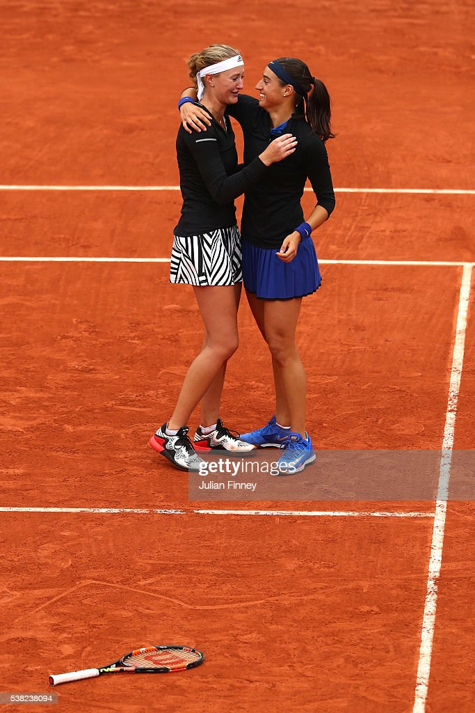 <a gi-track='captionPersonalityLinkClicked' href=/galleries/search?phrase=Kristina+Mladenovic&family=editorial&specificpeople=4835181 ng-click='$event.stopPropagation()'>Kristina Mladenovic</a> and <a gi-track='captionPersonalityLinkClicked' href=/galleries/search?phrase=Caroline+Garcia&family=editorial&specificpeople=6605758 ng-click='$event.stopPropagation()'>Caroline Garcia</a> of France celebrates victory during the Ladies Doubles final match against Elena Vesnina and Ekaterina Makarova of Russia on day fifteen of the 2016 French Open at Roland Garros on June 5, 2016 in Paris, France.