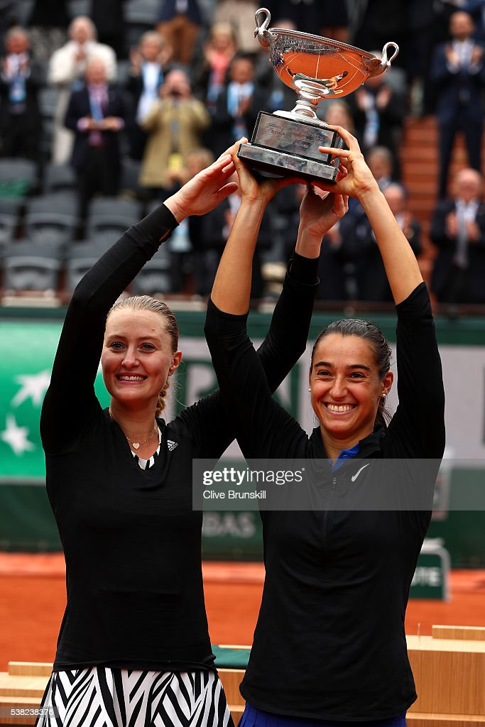 <a gi-track='captionPersonalityLinkClicked' href=/galleries/search?phrase=Kristina+Mladenovic&family=editorial&specificpeople=4835181 ng-click='$event.stopPropagation()'>Kristina Mladenovic</a> and <a gi-track='captionPersonalityLinkClicked' href=/galleries/search?phrase=Caroline+Garcia&family=editorial&specificpeople=6605758 ng-click='$event.stopPropagation()'>Caroline Garcia</a> of France lift the trophy following their victory during the Ladies Doubles final match against Elena Vesnina and Ekaterina Makarova of Russia on day fifteen of the 2016 French Open at Roland Garros on June 5, 2016 in Paris, France.