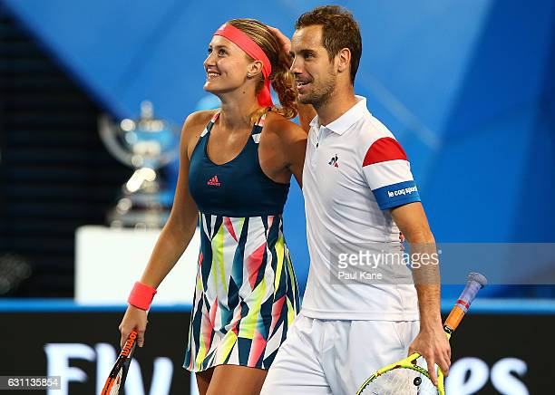 Kristina Mladenovic and Richard Gasquet of France celebrate winning the Hopman Cup final against Coco Vandeweghe and Jack Sock of the United States...