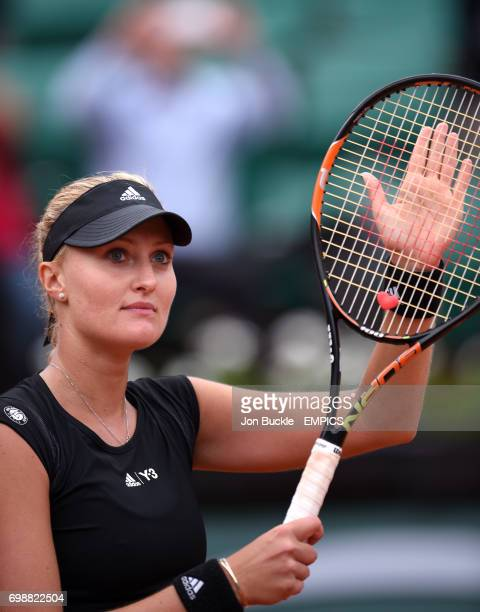 Kristina Mladenovic applauds the crowd after winning her 1st round women's singles match against Eugenie Bouchard on day three of the French Open at...